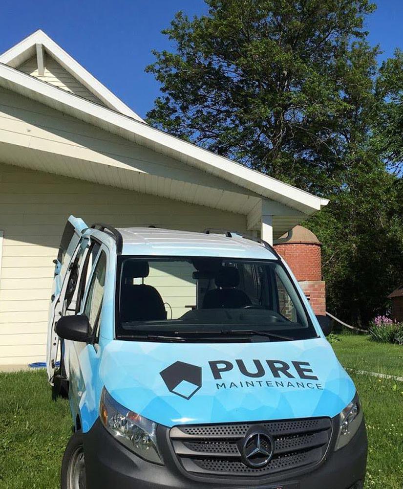 Pure Maintenance Van Outside a House